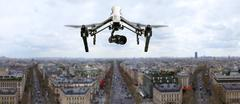 Drone flying above Paris city panorama Stock Photos