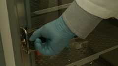 Lab Scientist Closing Door of a Container - stock footage