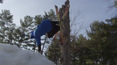 Stock Video Footage of Extreme Sport Winter Tricks on Ski Hill - Skier back flip on back country jump.