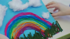 Rainbow-Applique of Colorful Threads Cotton Clouds Grass of Green Threads on a Stock Footage