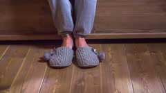 Stock Video Footage of Going to bed and taking off beautiful grey slippers
