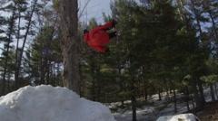 Extreme Sport Winter Tricks on Ski Hill Jumps - slow motion back flip - stock footage