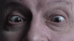 Man's face with slanting eyes, strabismus Stock Footage