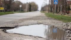 Holes on the asphalt road Stock Footage