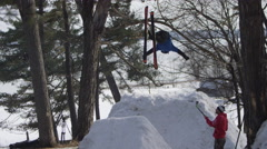 Extreme Sport Winter Tricks on Ski Hill Jumps - Back Flip from Behind - stock footage