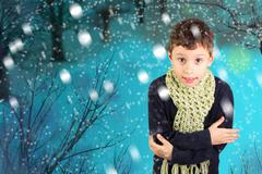 Little boy feeling cold in Winter - stock photo