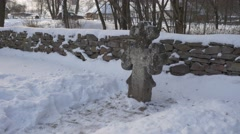 Courtyard of a Wooden Church Snow Cross Rustic Houses Village is Around Stony - stock footage