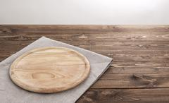 Background for product montage. Round wooden board with tablecloth. - stock photo