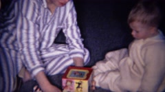 1961: Brother teaching baby jack in the box pop goes the weasel. Stock Footage