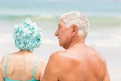 Senior couple in beachwear - stock photo