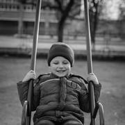 baby riding on the swing - stock photo