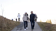 A couple of young people walking in the mountains. Stock Footage