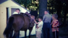 1962: Family readies wild nervous horse for recreational riding pleasure. Stock Footage
