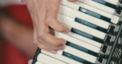 A finger masterfully strumming the accordion. - stock footage