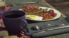 Beautiful Picnic Breakfast Spread With Coffee, Eggs, and Bacon Stock Footage