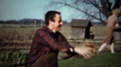 1961: Dad baseball catcher at rustic farm field of dreams background. Stock Footage