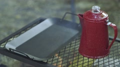 Coffee Pot and Frying Pan Over Campfire Stock Footage