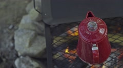 Overhead Pan On Coffee Pot Over Campfire Stock Footage