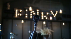 The camera on a tripod in the interior of the bar Pinky Bandinsky. Bulb light Stock Footage