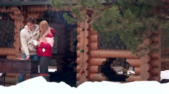 Stock Video Footage of Couple and barbeque in winter in village