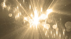 Moving gloss particles on gold background. - stock footage