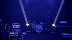 Three white spotlights, crossing each other. On the background of the drum set. Stock Footage