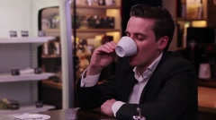 Man finishes his coffee, the waitress brings the bill - stock footage