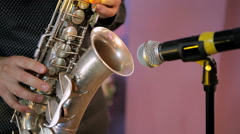 A man plays the saxophone in the concert Stock Footage