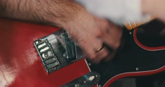 A finger masterfully strumming the guitar Stock Footage