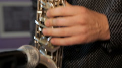 Playing on saxophone. Close-up on fingers pressing the keys of the instrument. Stock Footage