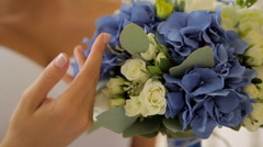 The bride's bouquet close up. the bride's bouquet. woman's hand. Stock Footage