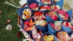 Wedding jewelry, colorful rose petals in a basket - stock footage