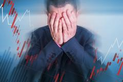 Broken Depressed Businessman Cover His Face. Men Who Lose All His Money Tradi - stock photo