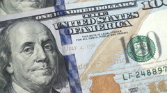 Zoom motion close-up view on dollar bills Stock Footage