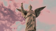 Angel Statue Against a Pink Sky Stock Footage