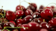 Sour cherries on white background slow tilting food natural Stock Footage