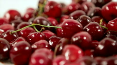 Lot of sour cherries on white background. slow pan Stock Footage