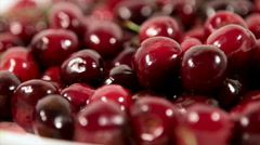Sweet cherries rotated plate, close up.  Stock Footage