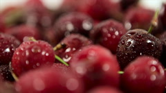 closeup of a movement in a circle. de-focused scene. ripe cherries with drops of - stock footage