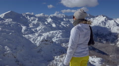 Mid shot - Young woman looking at the beautiful winter scenery Stock Footage