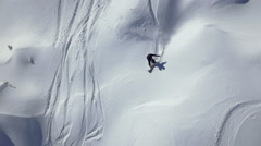 Slow motion - Aerial shot of snowboarder riding in powder snow Stock Footage