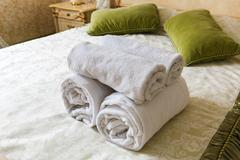 Towel in Hotel bedoom. Welcome guests, room service - stock photo