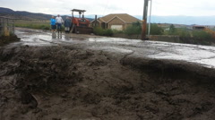 S171848-PAN-Homeowners watch raging flash flood threaten road to their home Stock Footage