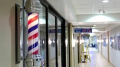 Motion of barbershop pole spinning at barber shop hub Stock Footage