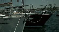Bows of Two Sail Boats Bobbing - stock footage