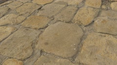 Paving Stone Road Paved With Stones Bricks Walls Way to a Dormition Cathedral - stock footage