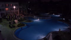 Empty swimming pool in hotel at night 1 Stock Footage