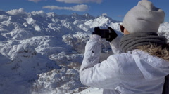 Close up -  Young woman photographing beautiful winter scenery - stock footage