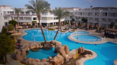 Empty hotel with swimming pool 1 Stock Footage