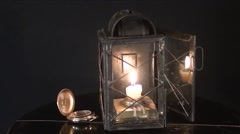 A candle burns in the old lamp, on a black background Stock Footage